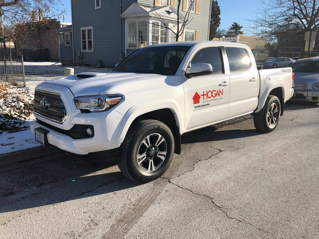 Toyota Tundra truck with red Hogan logo on side