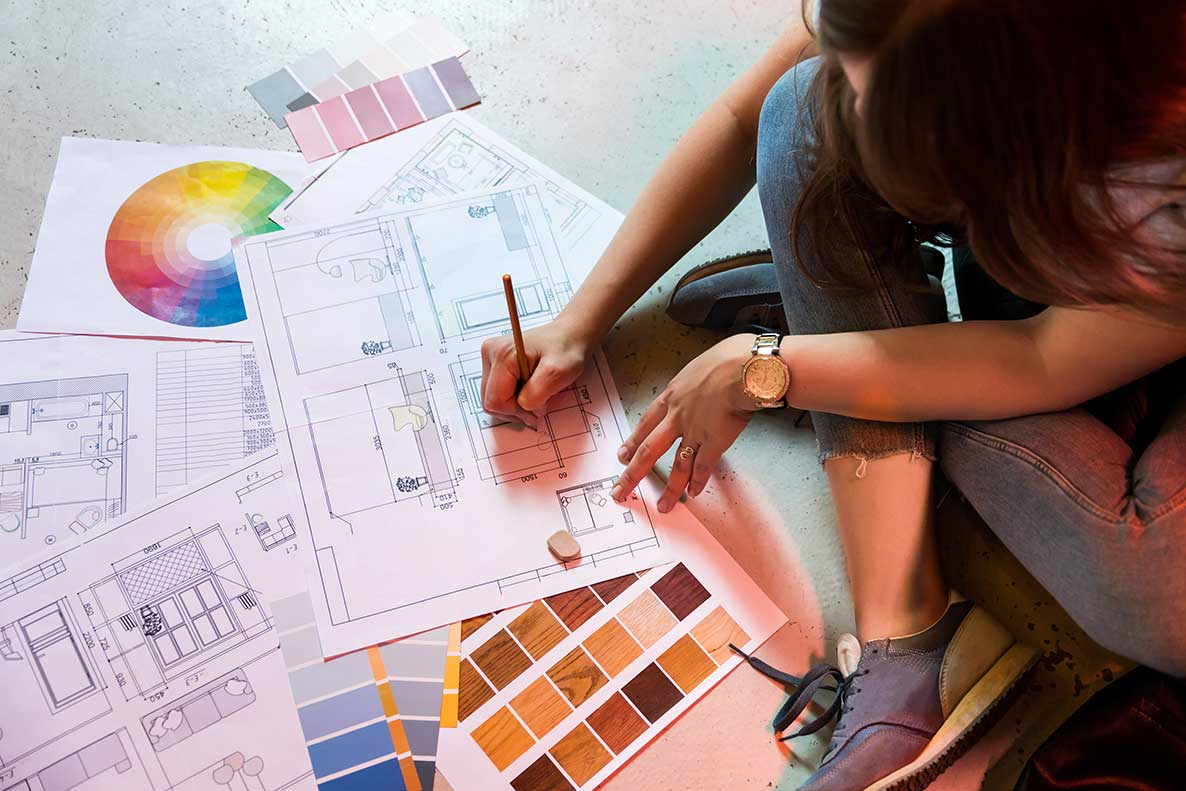 Person picking colors for remodeling plan with color swatches