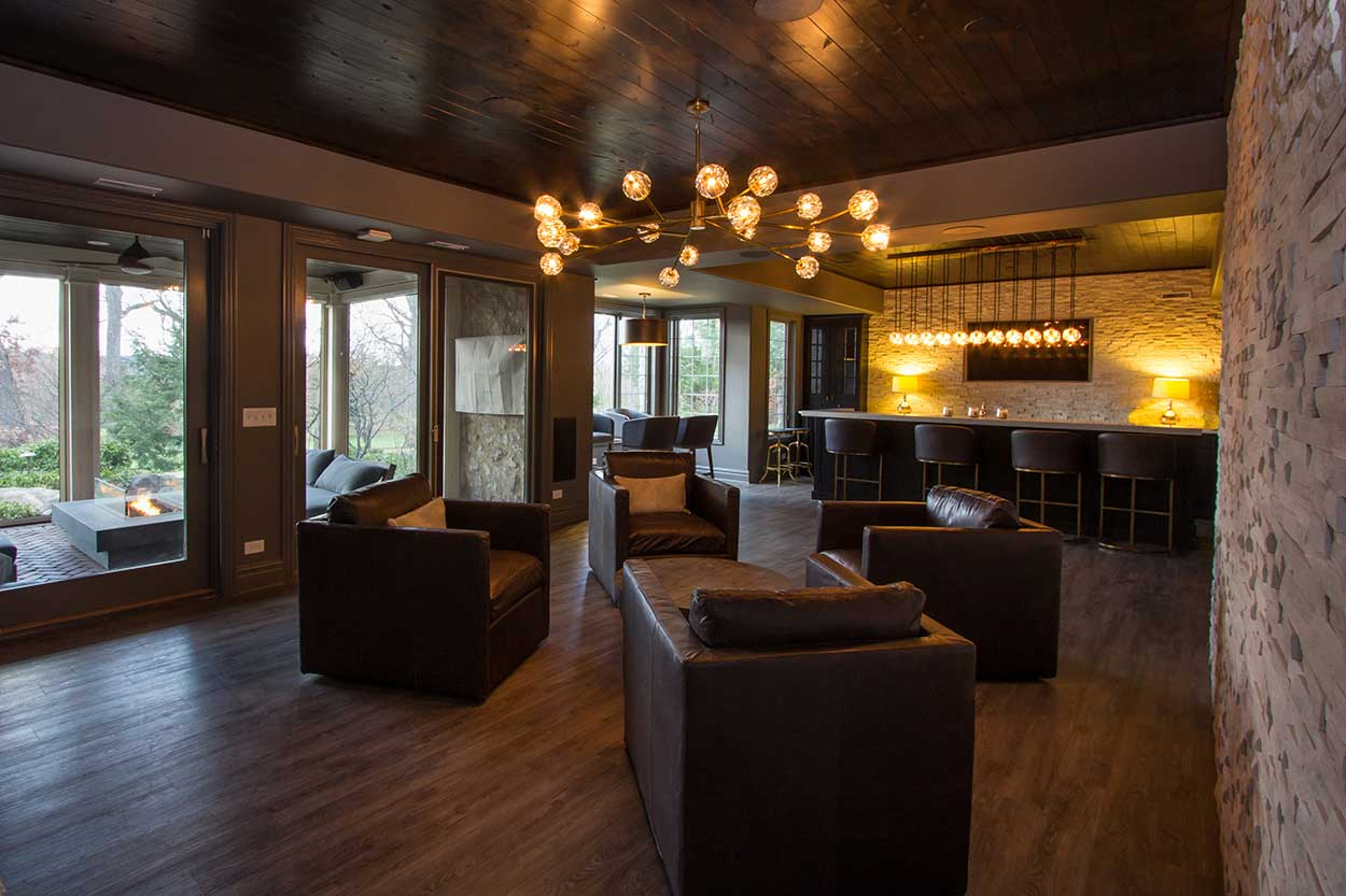 Full room view of basement living area and bar