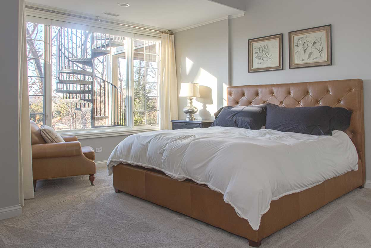Bed with brown leather head board and matching chair