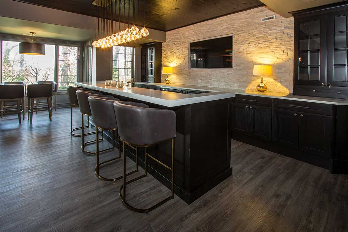 Counter-top with hanging lights and black cabinets