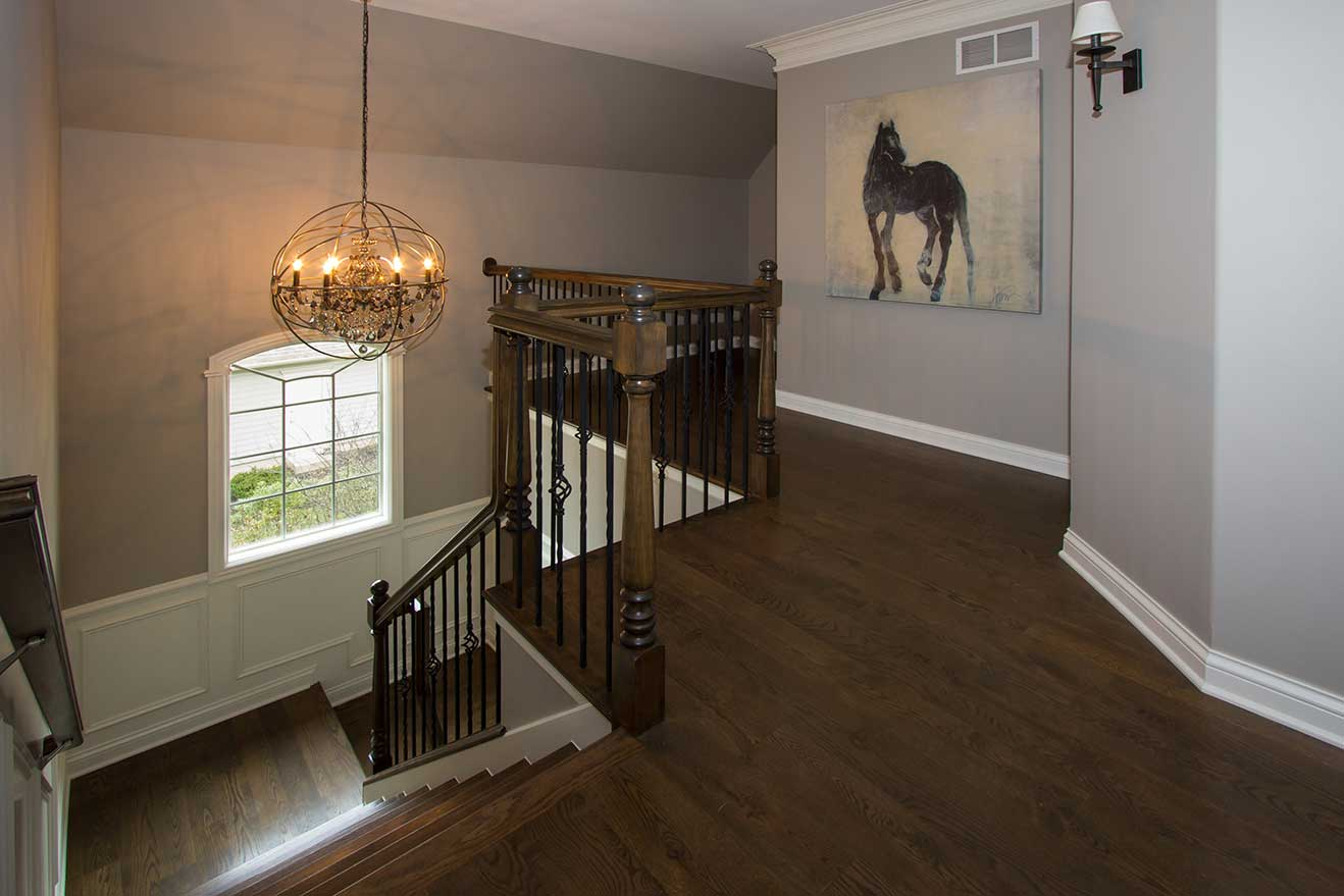 staircase with globe lamp and picture of a horse