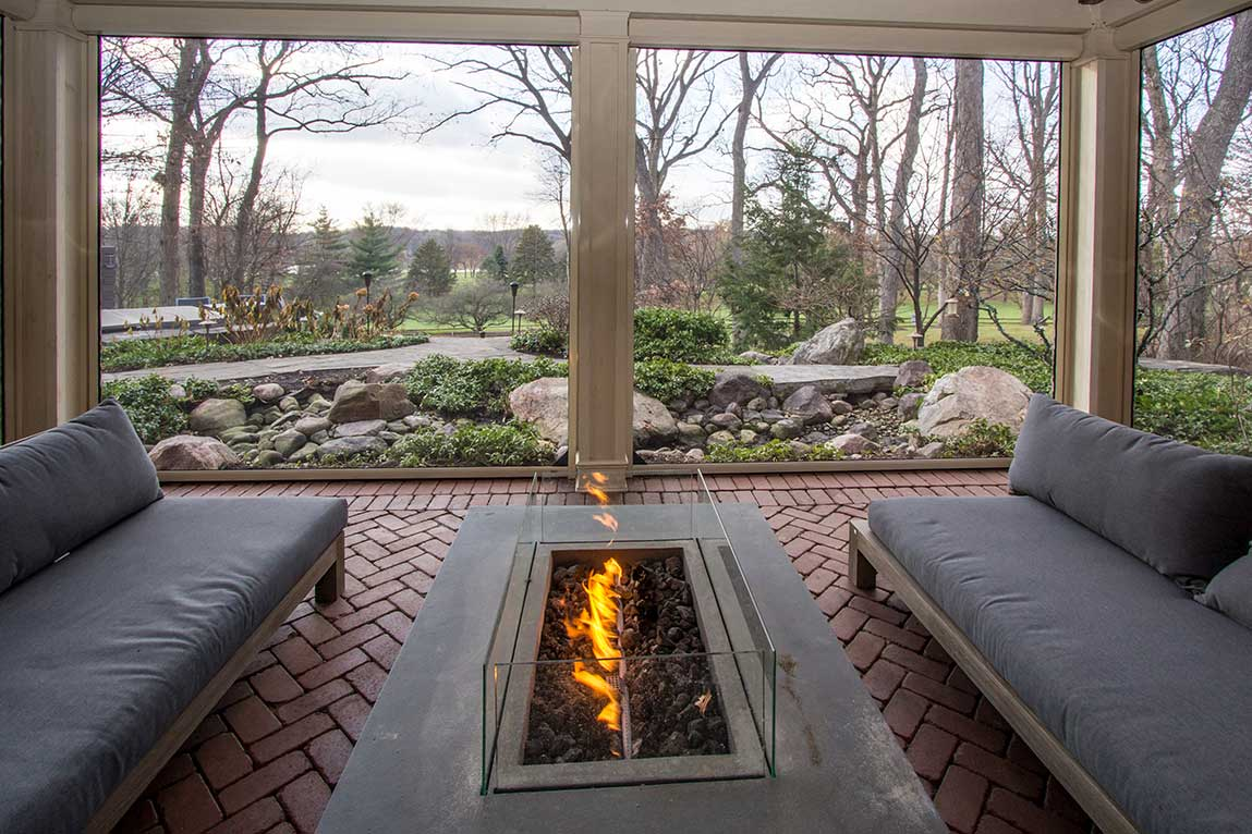 Fireplace outdoors designed by Hogan Design & Construction