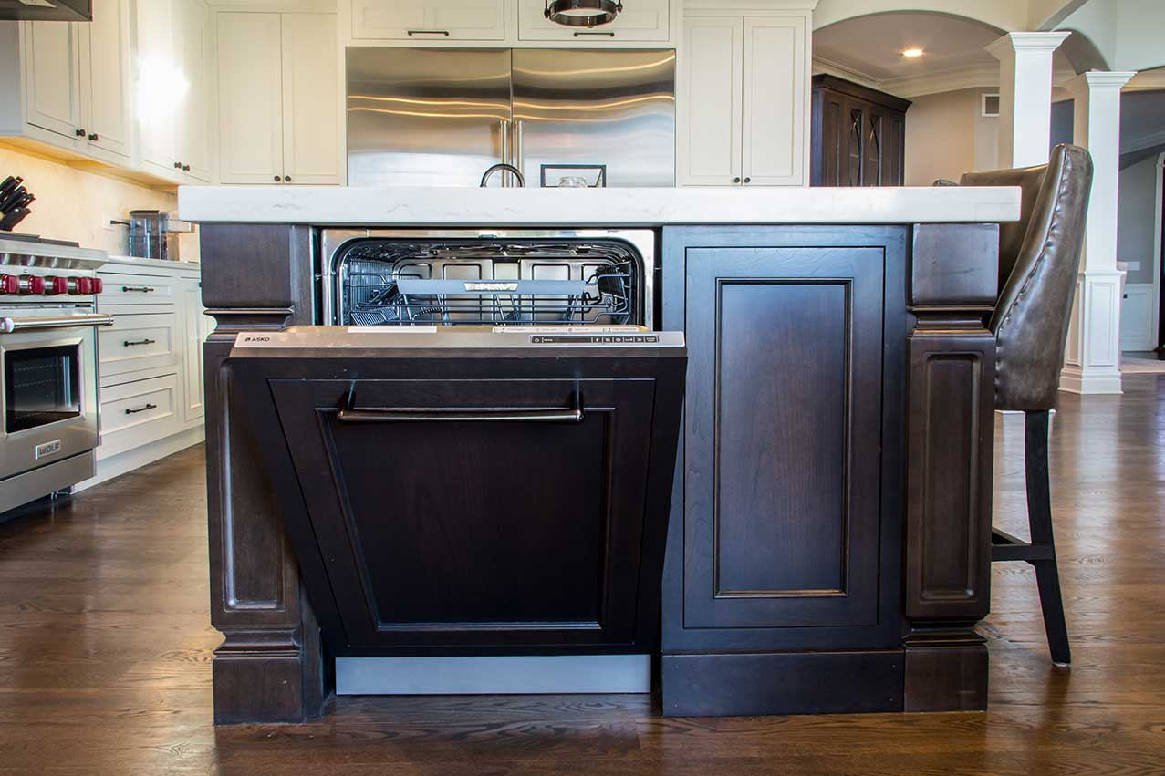Wood island with built in dishwasher and marble counter top