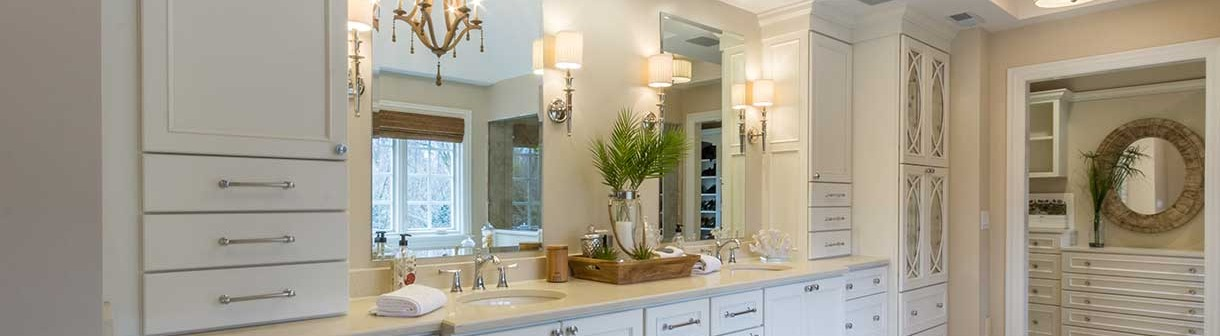 Two large mirrors above double sink