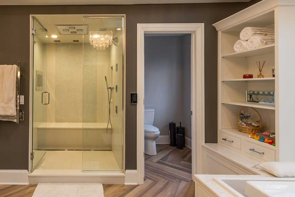 Glass shower door and bathroom door with white shelf