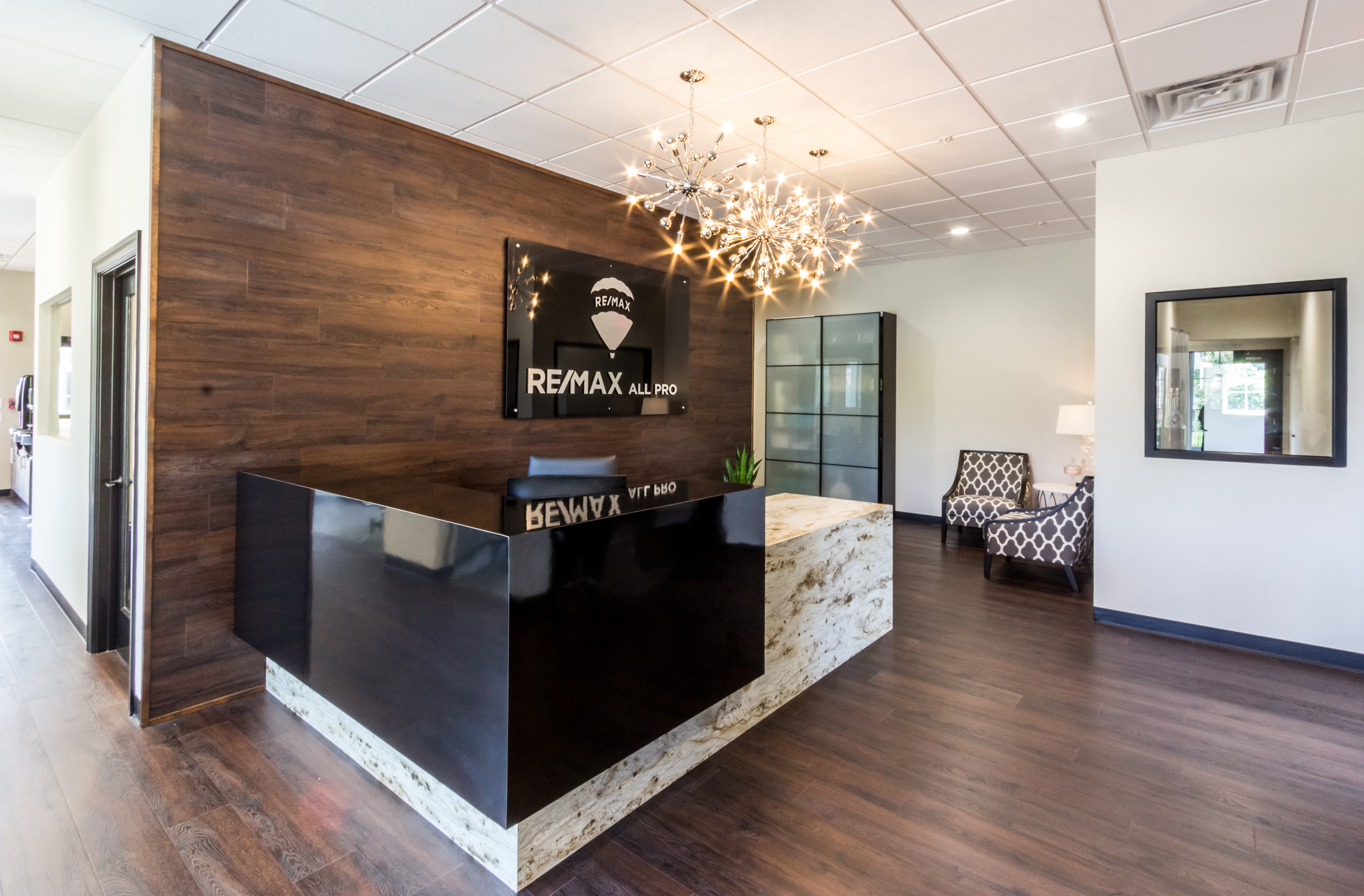 Remax reception desk under three globe lights
