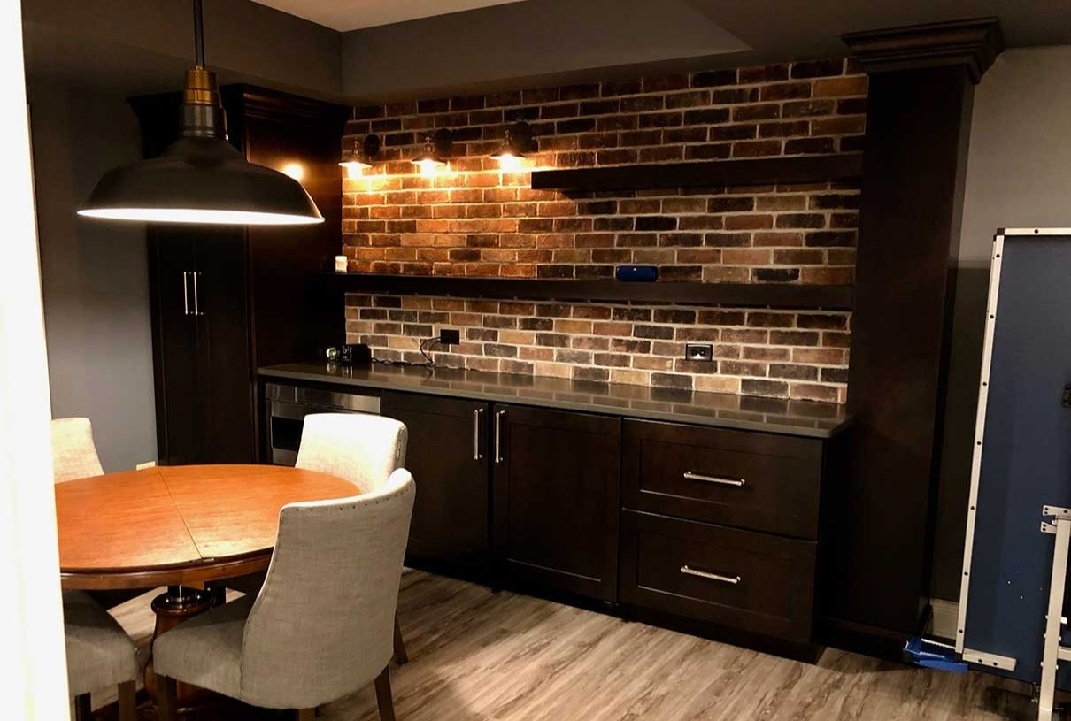 Basement dining area with granite counter top and stone backsplash
