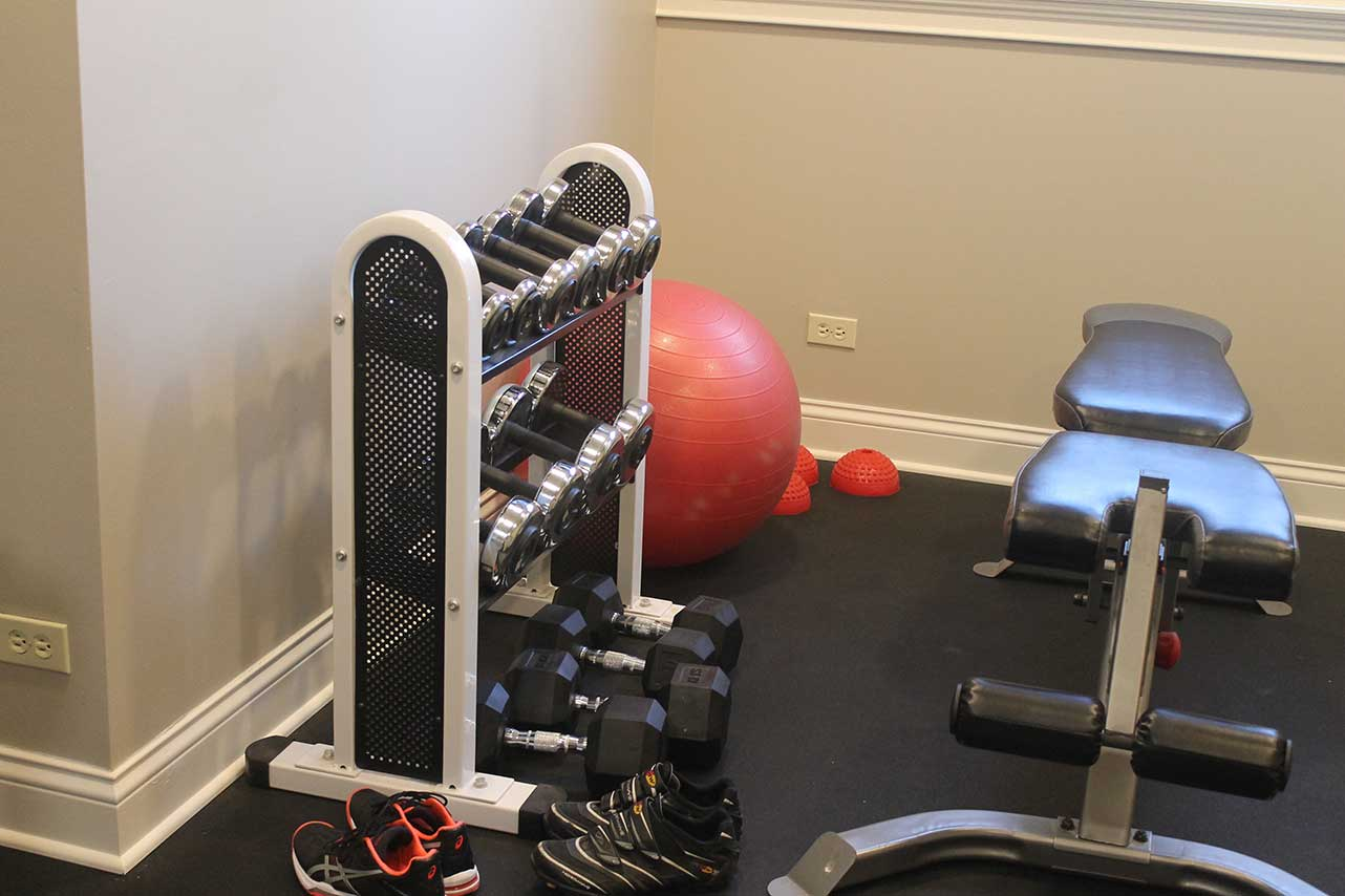 Workout equipment in basement remodel