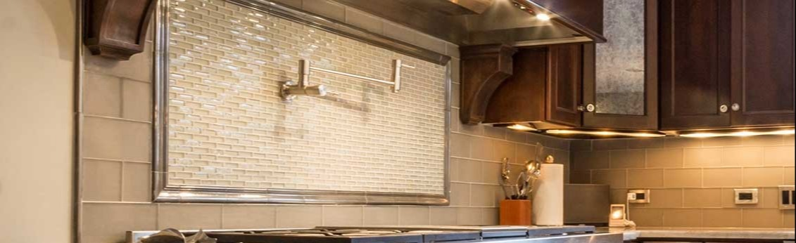 Stove and counter with glass tile backsplash