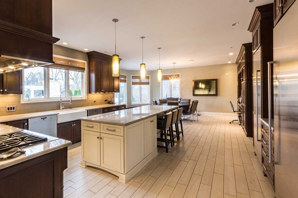 Entryway view of kitchen with granite island and light wood flooring
