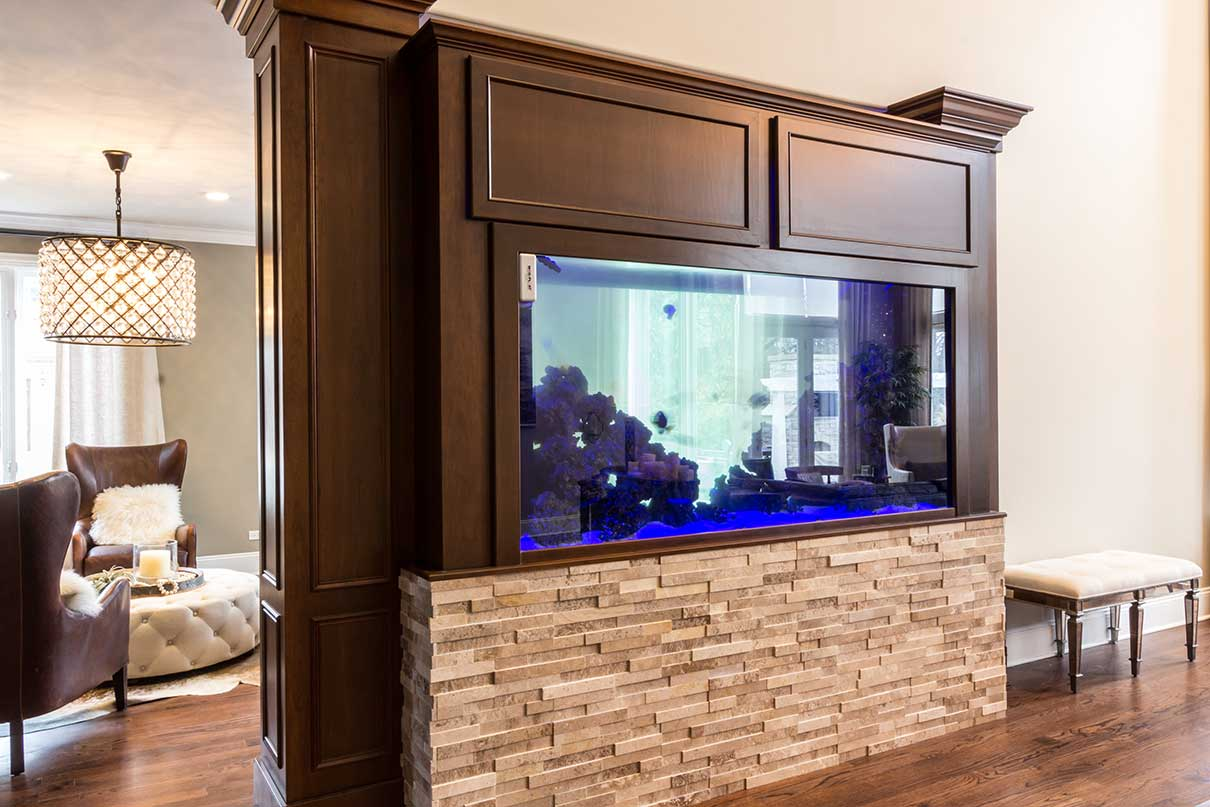 Stone and wood fishtank in front of living room