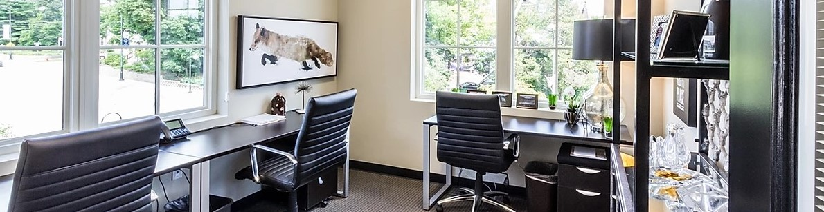 Black desks in beige colored workspace