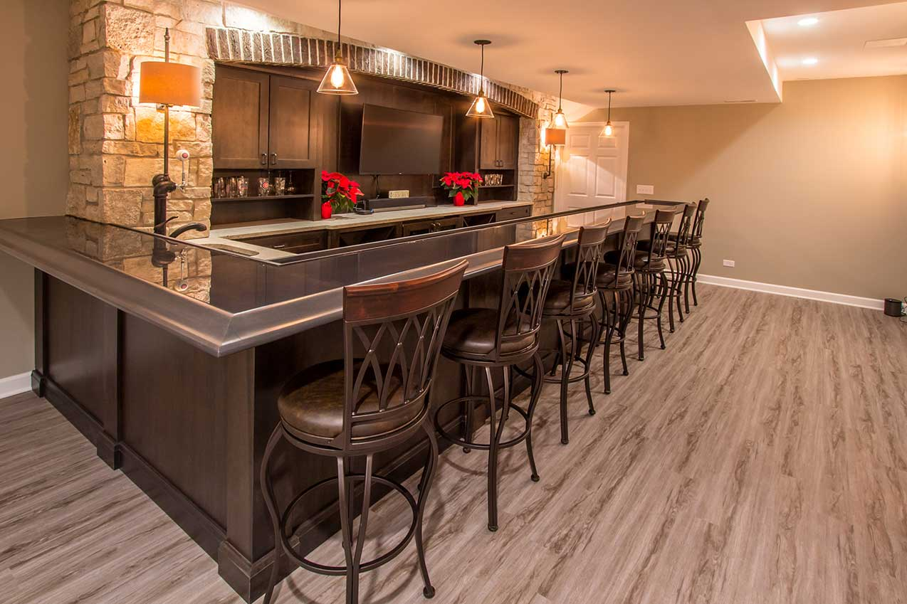 Bar with high back chairs and red flowers