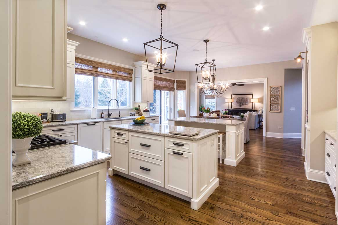 Granite counter and white cabinets in white kitchen