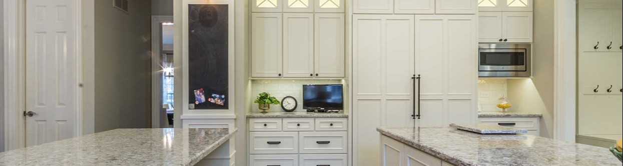 White cabinets behind granite counters