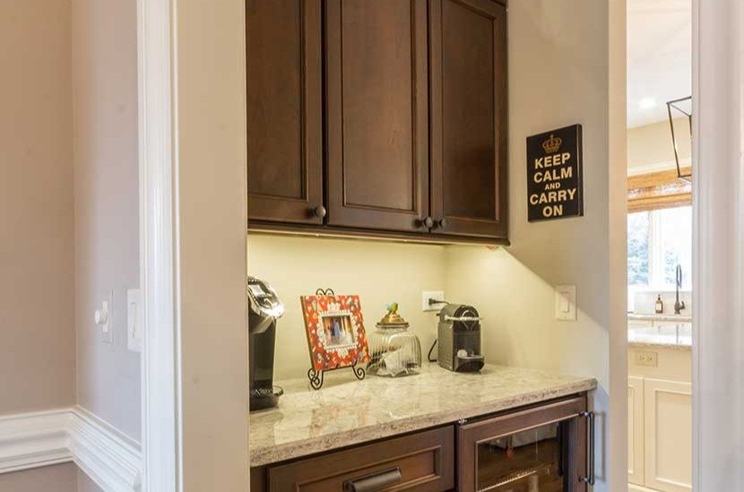 Alcove with granite counter and yellow light