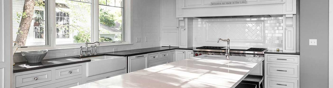 white kitchen counter-top with stove and white cabinets