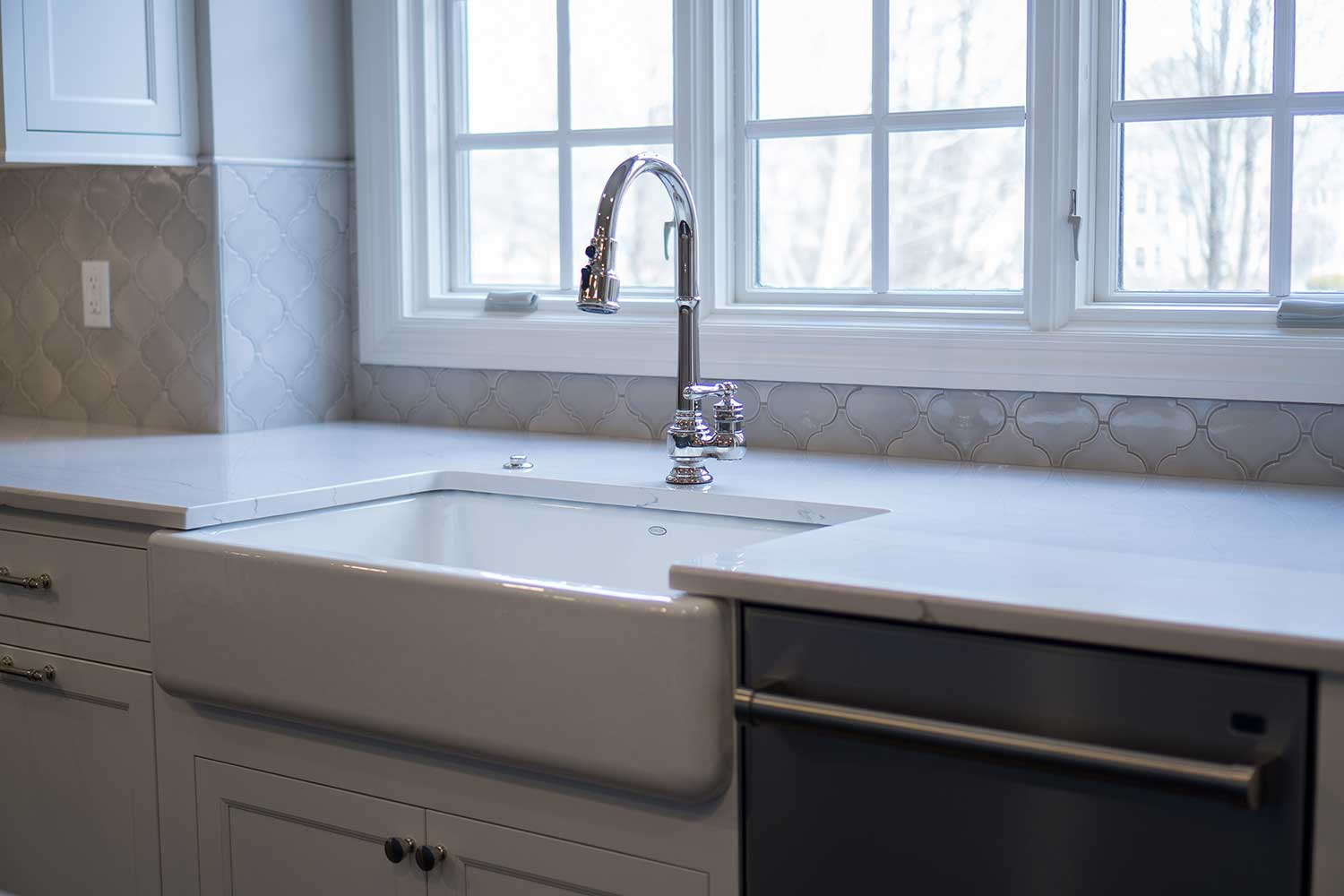 White marble counter with silver faucet and drop down sink