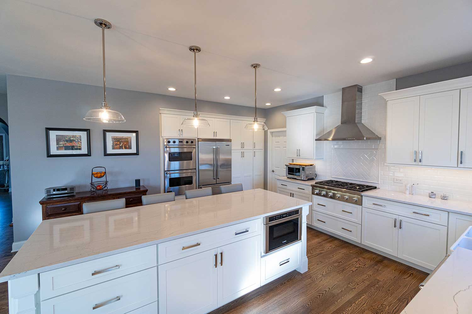 Marble island with oven and white cabinets