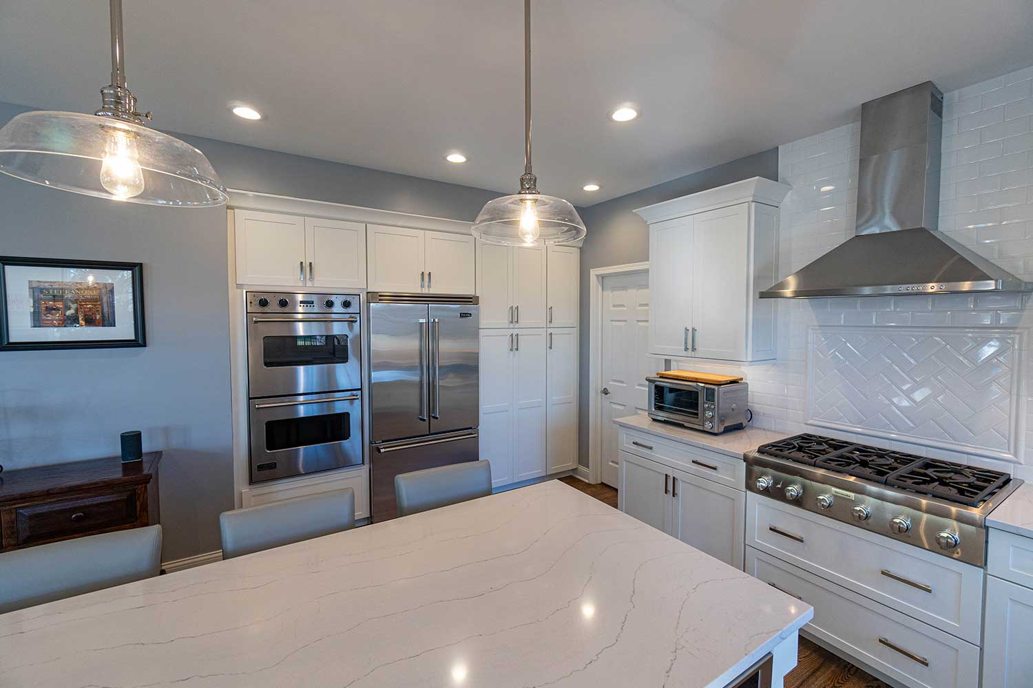 White cabinets behind with silver appliances
