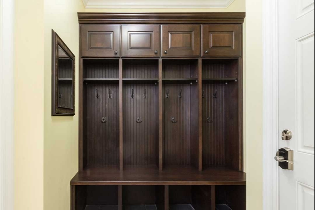 Mudroom closet and shelving unit with cream walls