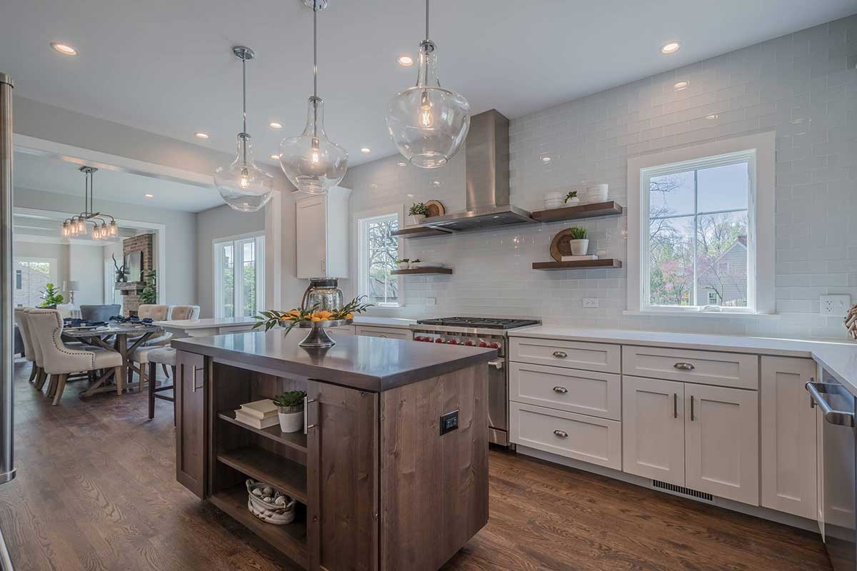 River lane kitchen with wooden island and marble counter top