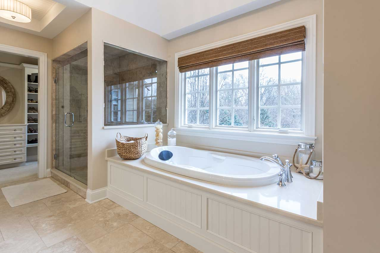 White ceramic tub with windows behind