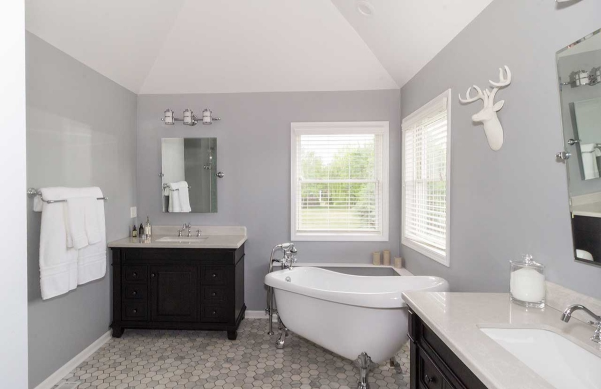 grey walls bathroom remodel with white counters