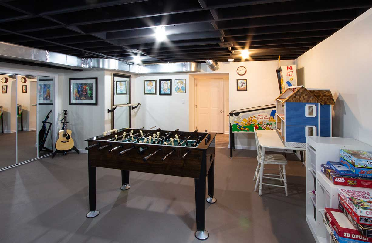 Basement recreation room with foose ball table and games