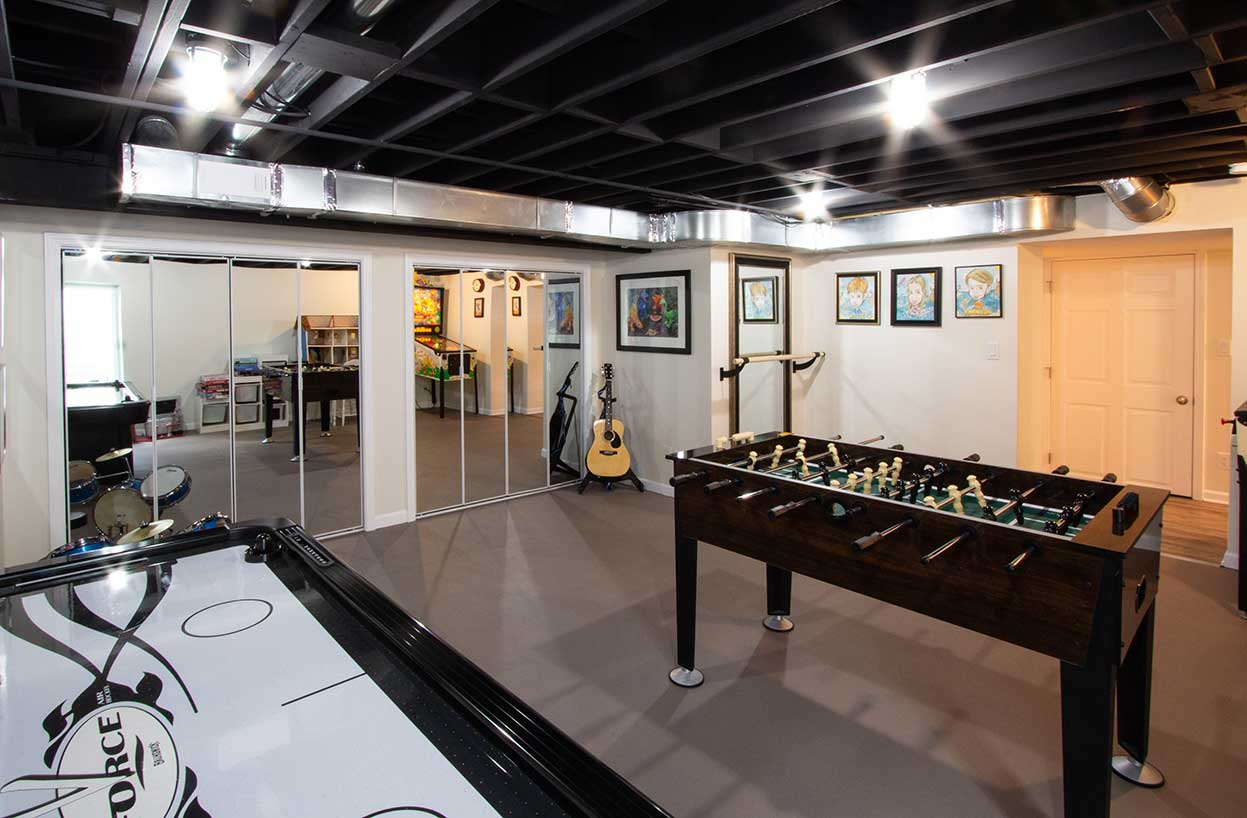 Foose ball table with mirrored wall and air hockey table