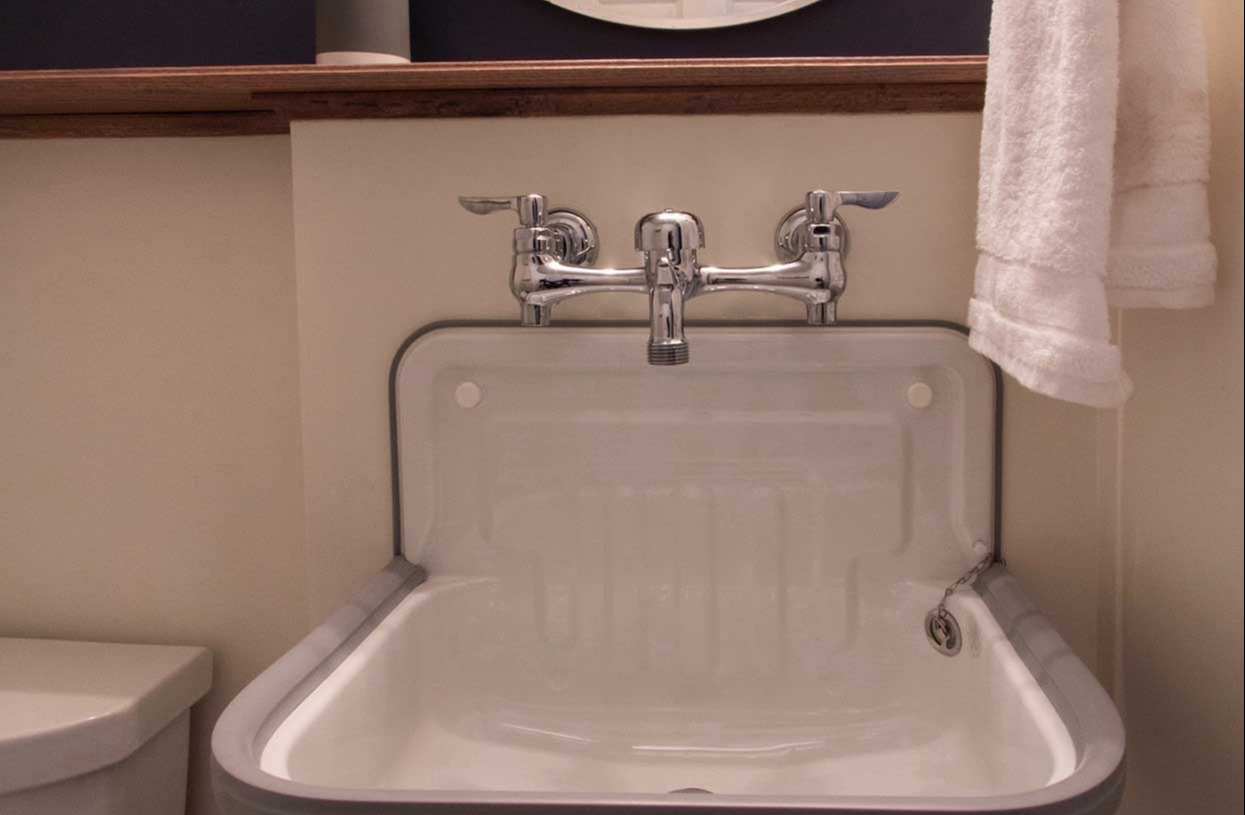 White sink with silver faucet