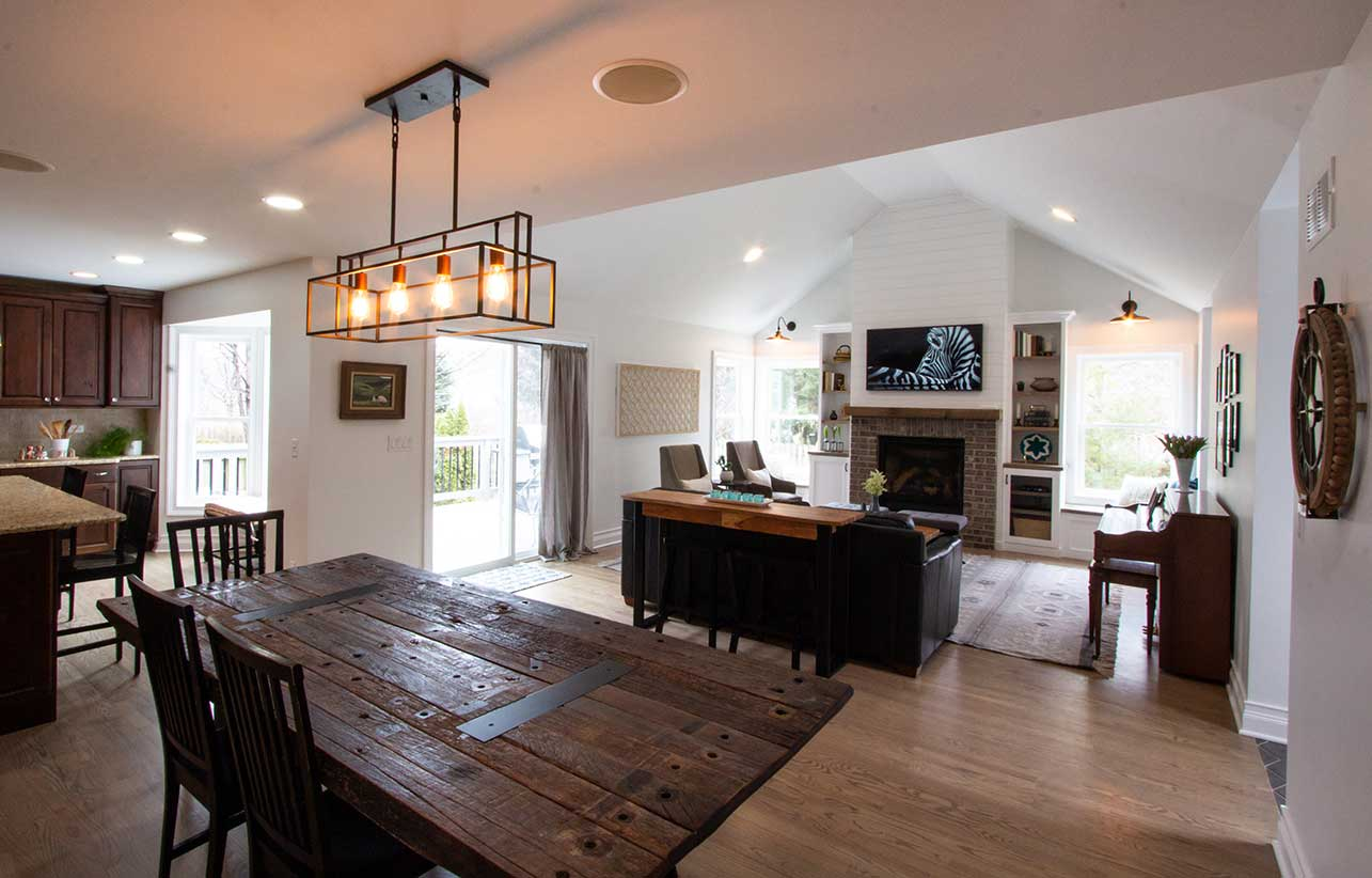 Wooden table with square hanging lights in front of living room