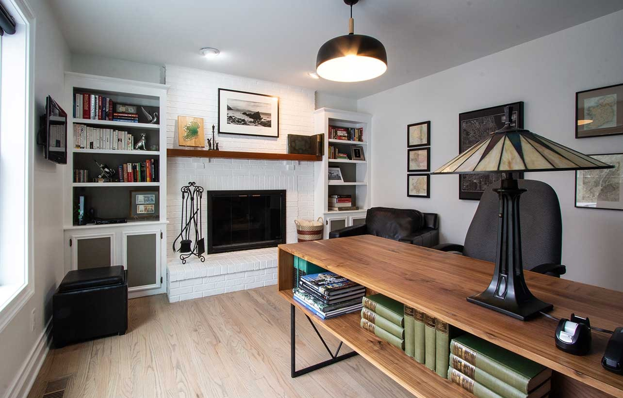 Office desk with bookcases and lamp