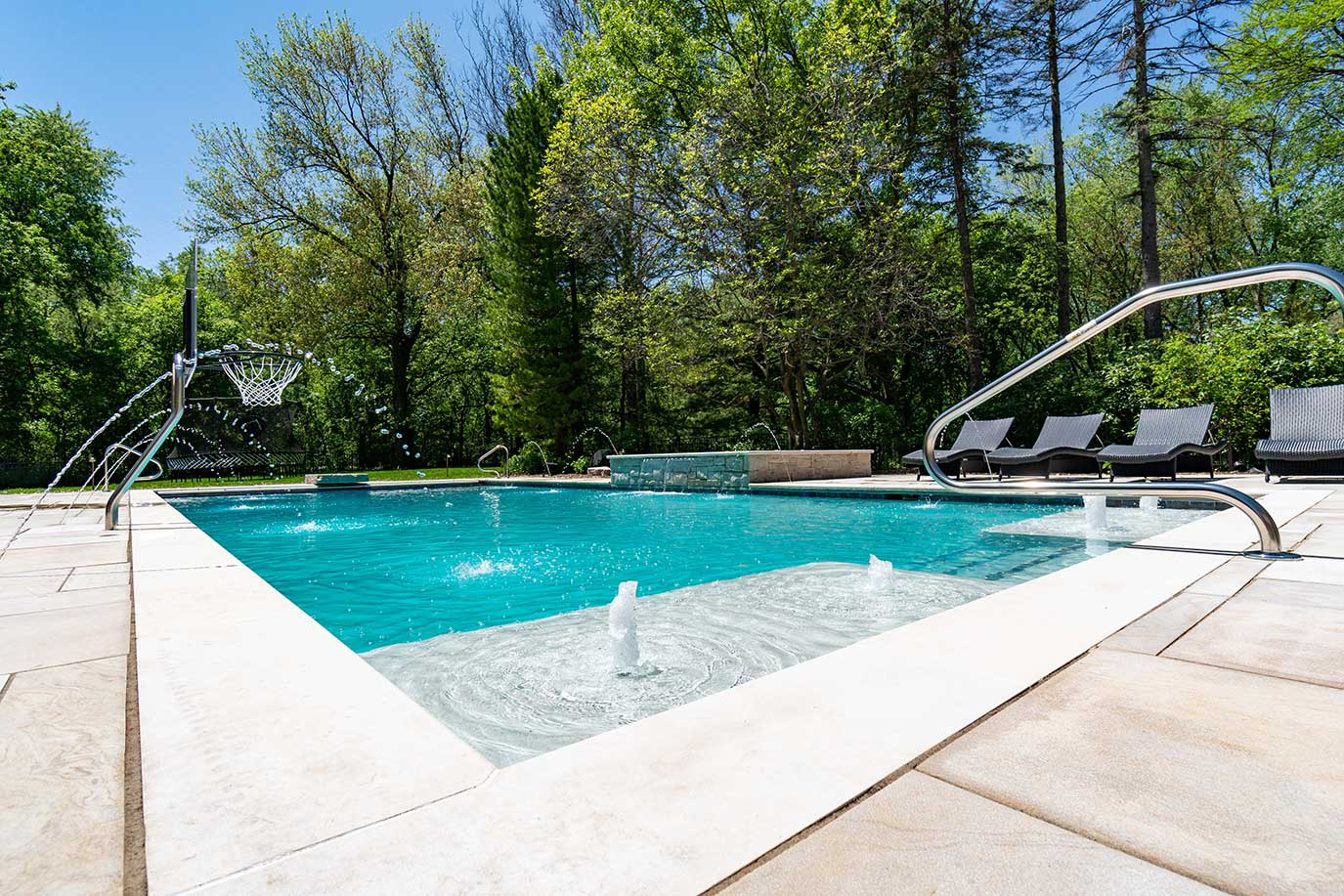 Pool with fountains and basketball hoop